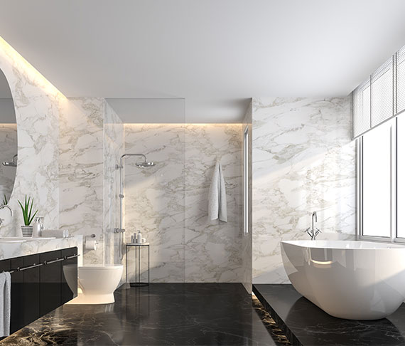 luxury bathroom remodel with black marble floor and white marble wall
